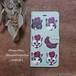 手帳型スマホケース/猫とパンジー Plus/Lサイズ