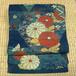 濃い青色に大柄の菊 織りの名古屋帯