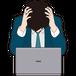 パソコンの前で頭を抱える男性ビジネスマン