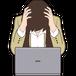 パソコンの前で頭を抱える女性ビジネスマン