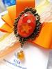【ハロウィンカラー】月と星の輝く宇宙りぼんブローチ オレンジ