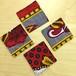 アフリカ布のコースター・4枚セット(赤系)