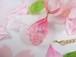 桜が入ったしずくのチャームが揺れるフェイクレザーチョーカー
