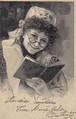 古絵葉書エンタイア「本を読み聞かせていると思われる女性」(1904年)