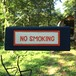 NO SMORKING sign